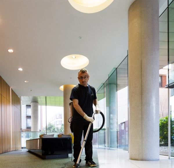 vacuuming the hallway